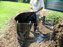 Fasten black sheeting to top of the compost bin with cloths pins.